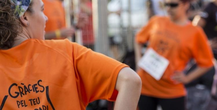 Moments previs a l'última cursa de Festa Major amb participació de voluntaris del KmSolidari/ Esquitx