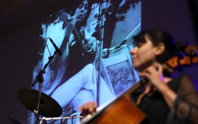 Un moment de l'acte amb una fotografia de Rebull a la pantalla | Ruben Moreno